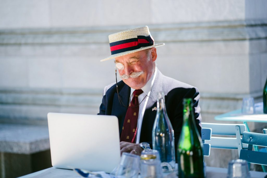 happy old man with laptop